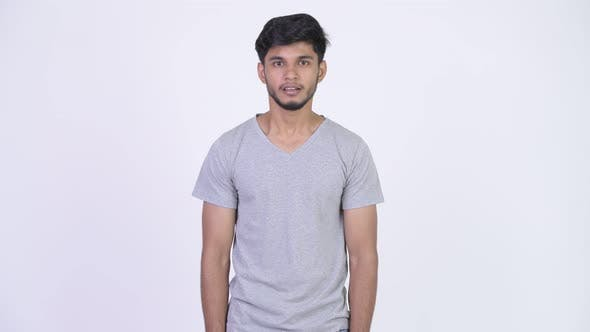 Thumbnail for Young Happy Bearded Indian Man Looking Excited