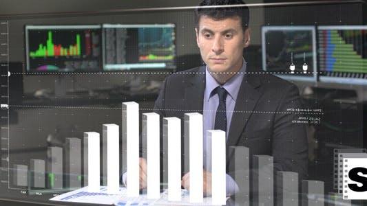 Thumbnail for Businessman Checking Charts