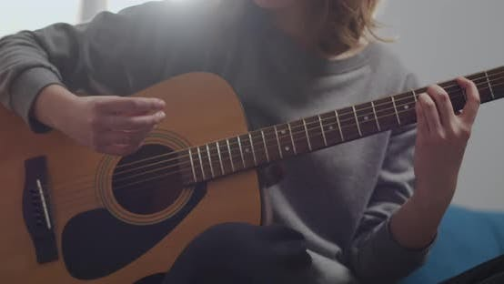 The Girl Is Learning To Play the Guitar