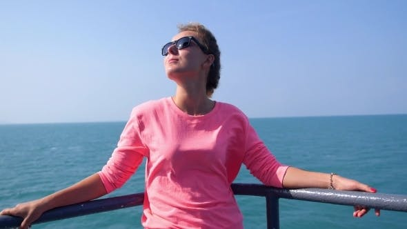 Thumbnail for Attractive Girl Enjoying Sunny Day On Yacht Deck