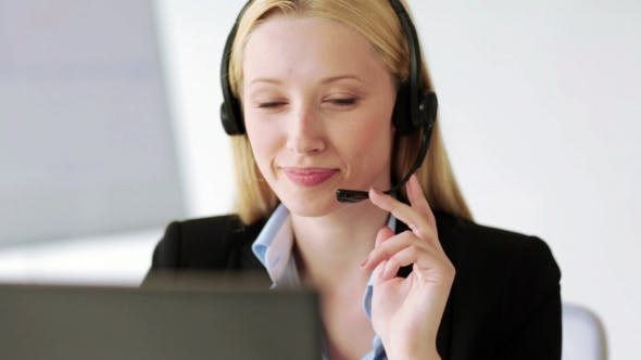 Thumbnail for Smiling Helpline Operator Receiving Call In Office
