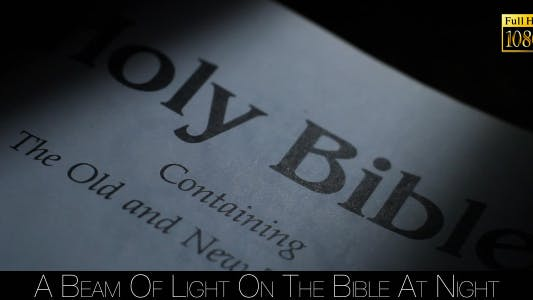 Thumbnail for A Beam Of Light On The Bible At Night 2