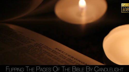 Thumbnail for Flipping The Pages Of The Bible By Candlelight
