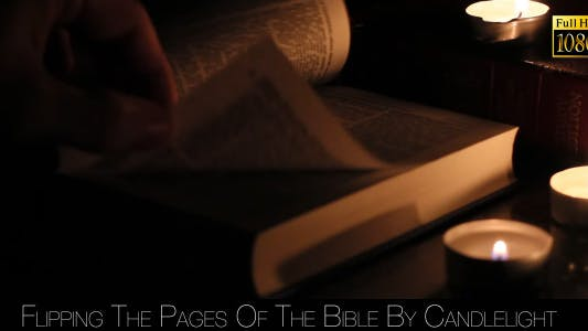 Thumbnail for Flipping The Pages Of The Bible By Candlelight 4