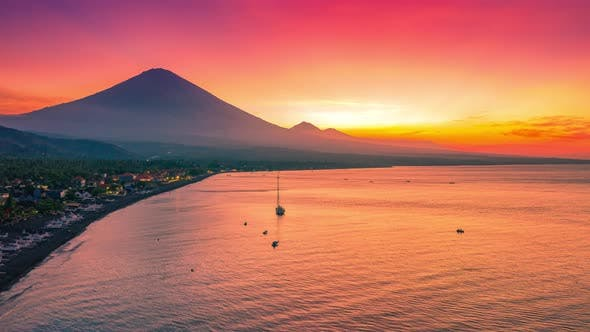 Cover Image for Beautiful Sunset in Amed on the Beach with Local Boats and View of Agung Volcano in Bali, Indonesia