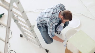 Man With Paintbrush And White Paint Painting Box