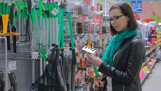 Thumbnail for The Girl At The Store Chooses Equipment For Garden