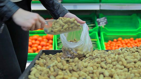 Thumbnail for The Girl In A Shop Buying Peanuts