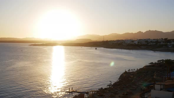 Thumbnail for Timelapse of Romantic Sunset on the Sea. Sun Going Down Over Horizon with Mountains at Sunset
