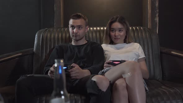 Thumbnail for Portrait Handsome Young Guy with His Girlfrend Having Fun Playing Video Games with Excellent Mood in