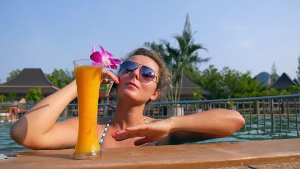 Thumbnail for Young Woman Using Cell Phone In Pool