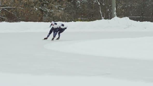 Cover Image for Speed Skaters Competing in Outdoor Ice Rink