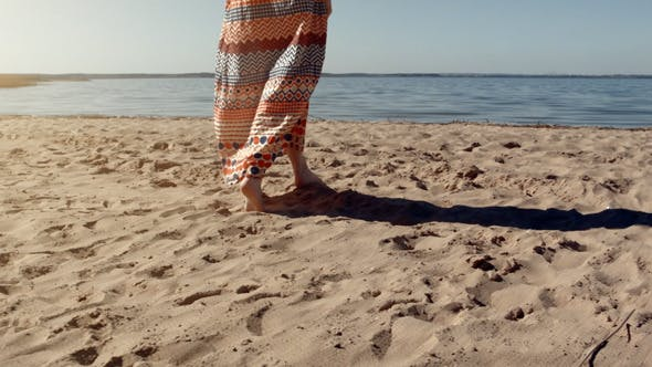 Thumbnail for Young Woman Walking On The Sand