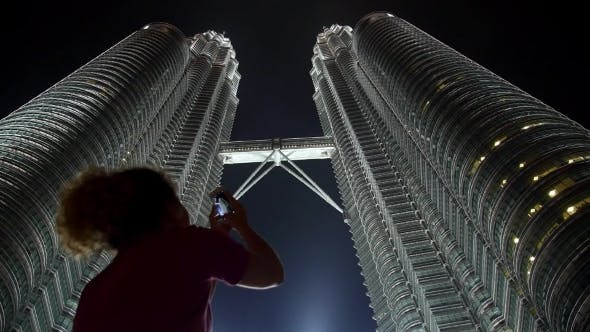 Thumbnail for Woman Taking Picture Of Petronas Twin Towers With