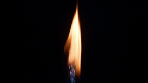 Cover Image for Burning Match On a Black Background Slow Motiion