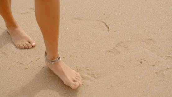 Thumbnail for Bare Feet Coated In Sand Walking On Beach