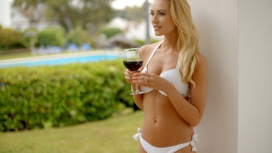 Thumbnail for Woman In White Bikini Holding Glass Of Red Wine