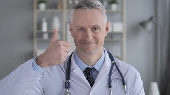 Thumbnail for Thumbs Up By Positive Doctor with Grey Hairs