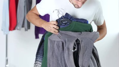 Guy Is Holding the Clothes