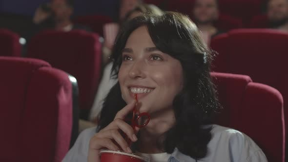 Thumbnail for Beautiful Brunette Enjoying Movie in the Cinema