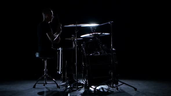 Thumbnail for Drummer Plays Energetic Music on the Drum. Black Background. Side View