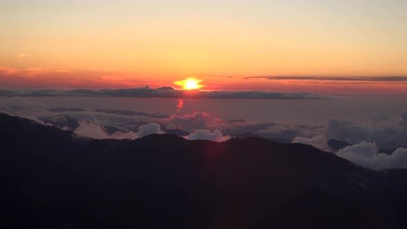 Sunset From the Misty and Cloudy Mountain Peak