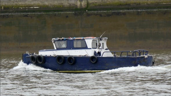 Thumbnail for A Blue Small Ferry Boat Crossing the Thames River