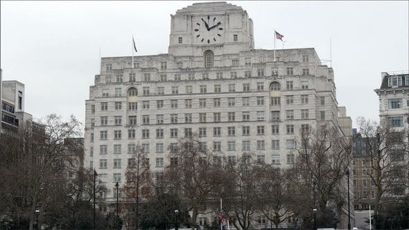 Thumbnail for The Huge White Building with a Black Clock on Top
