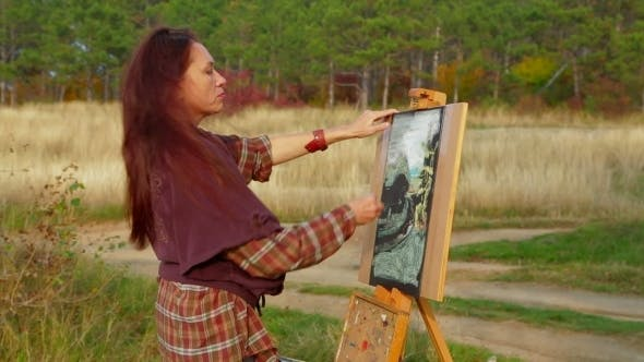 Thumbnail for Middle Aged Woman Drawing A Picture Plein Air