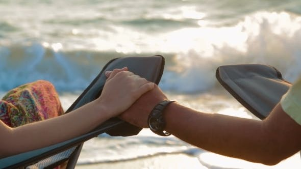 Thumbnail for Loving Couple Holding Hands While Sitting On