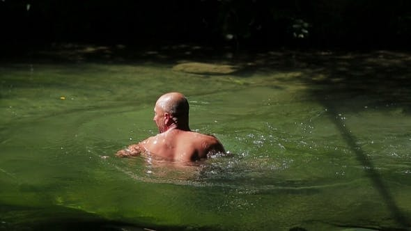 Thumbnail for Man Swimming In River