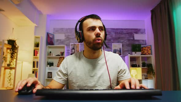 Pov of Concentrated Young Professional Gamer