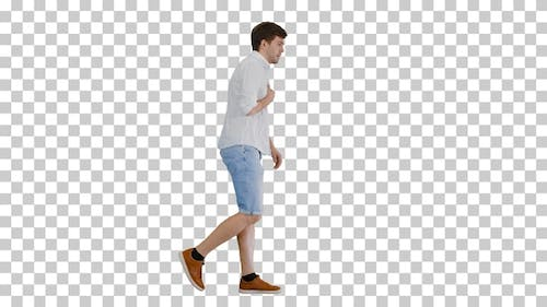 Exhausted young man walking and touching, Alpha Channel