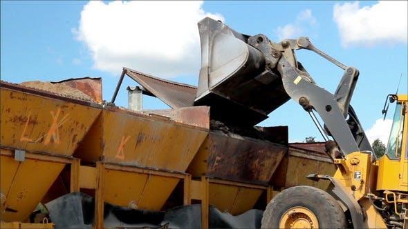 Bulldozer Adding Gravel to Gravel Bucket Filtering