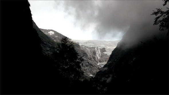 Thumbnail for At the Top of the Mountain with Fogs and Glacier