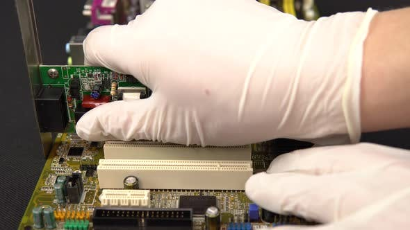 Thumbnail for Removing a Network Card from The Motherboard. Network Data Transmission System via Wire. Many