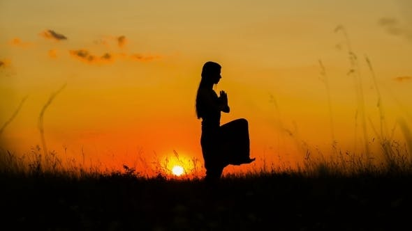 Thumbnail for Silhouette Of a Young Girl Doing Yoga At Sunset