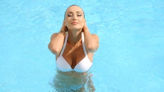Thumbnail for Woman At The Pool Holding Her Head Sensually