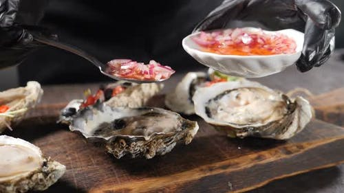 Slow Motion Sea Food Video. Big Oyster Dish. Serving Oysters in Fish Restaurant. Pouring Fresh