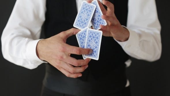 Thumbnail for Magician Man Showing Trick With Playing Cards