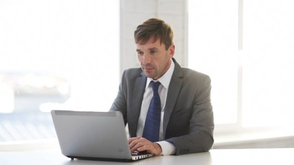Thumbnail for Businessman Working With Laptop Computer