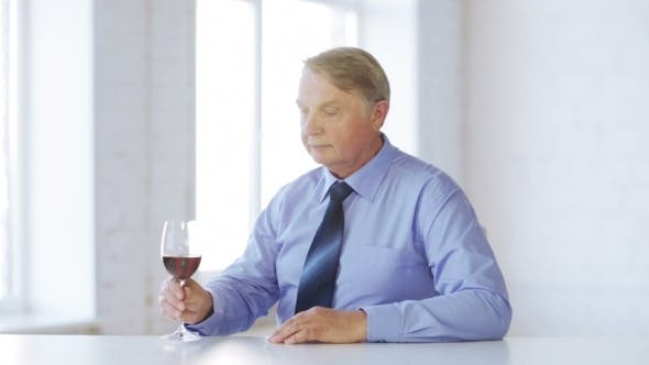 Thumbnail for Senior Sommelier With Glass Of Red Wine