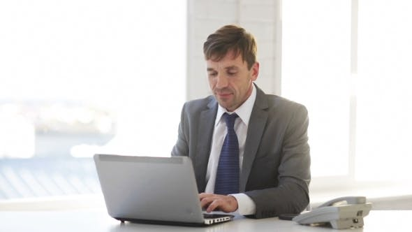 Cover Image for Businessman Working With Laptop Computer