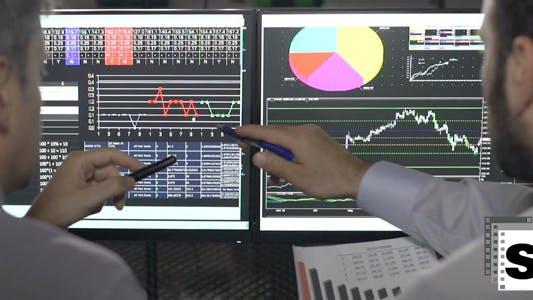 Thumbnail for Traders Analysing Stock Market