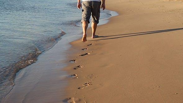 Thumbnail for Feet Of Man Walking Along Edge Of Sea Leave