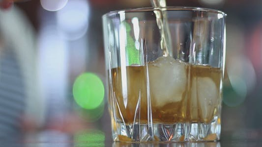 Thumbnail for Bartender Pours Whiskey with Ice