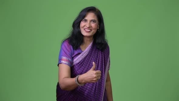 Thumbnail for Mature Happy Beautiful Indian Woman Giving Thumbs Up While Wearing Sari Traditional Clothes
