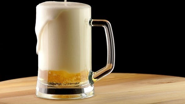 Cover Image for Light Beer is Poured into a Mug