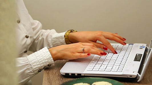 Cover Image for Woman Using Computer