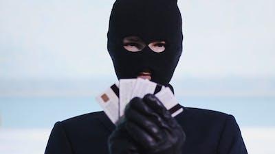 Thief Shows a Stolen Bank Card